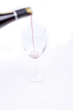 A glass of red wine isolated on white background, photo