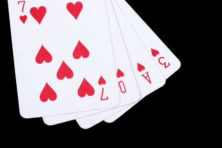 love playing cards isolated on a black background, photo