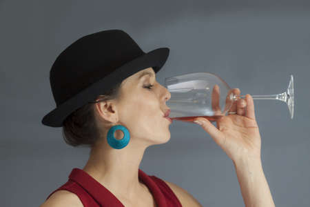 Beautiful woman drinking wine photo