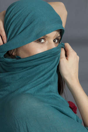 Woman with green  shawl on face photo