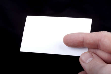 Man hand holding a blank business card.