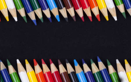 Color pencils isolated on black background Stock Photo