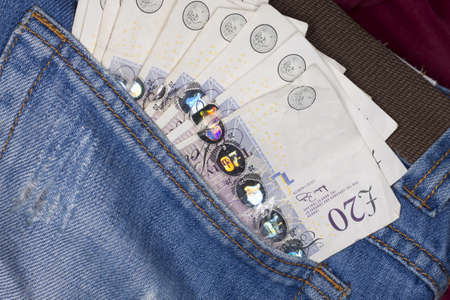 Photo of money in jeans pocket Stock Photo