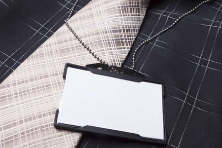 Card empty ID badge on man suit Stock Photo - 20918795