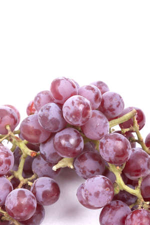 Cluster of red grapes isolated on a white background Stock Photo