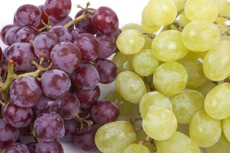 selenium: A bunch of green and red grapes isolated on a white background