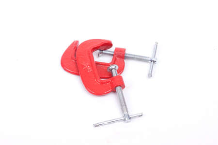 clamps: Red clamps isolated  on a white background Stock Photo