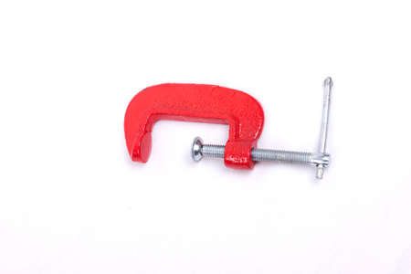 constrain: Red clamp isolated on a white background Stock Photo