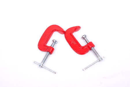 clamps: Red clamps isolated on a white background