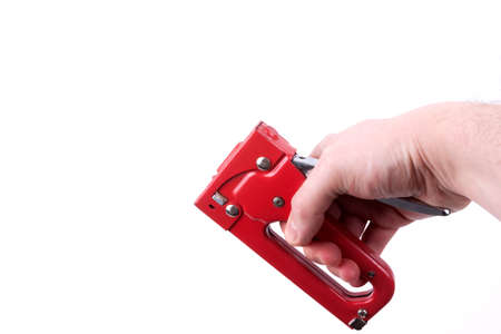 Construction stapler in a hand,  isolated on a white background photo