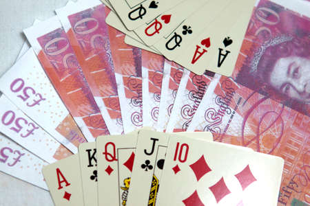 Playing cards and money in casino Stock Photo