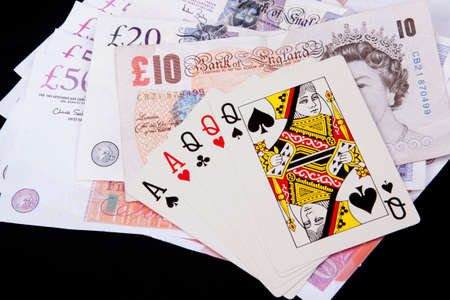 Playing cards and money in casino.