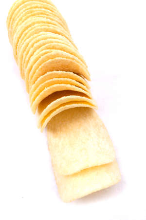 Tasty potato crisps  chips  isolated on a white  Stock Photo - 24976454