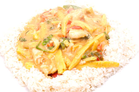rancid: diced chicken in coconut curry sauce served with rice
