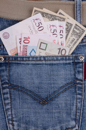 money in a jeans pocket photo