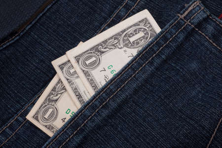 money in a jeans pocket