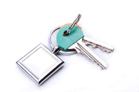 A bunch of keys with a key ring, isolated on a white background  Stock Photo