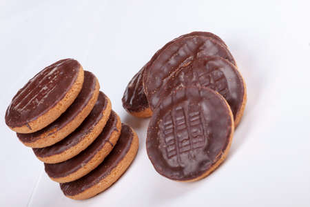 jaffa: Pile of chocolate coated jaffa cakes  on a white background.