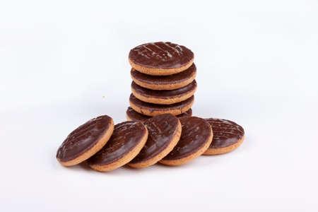Pile of chocolate coated jaffa cakes  on a white background.