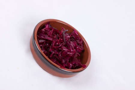 photo of pot of red coleslaw isolated on a white background Stock Photo