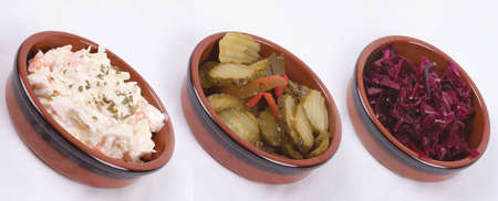 photo of 3 pots with salads isolated on a white background