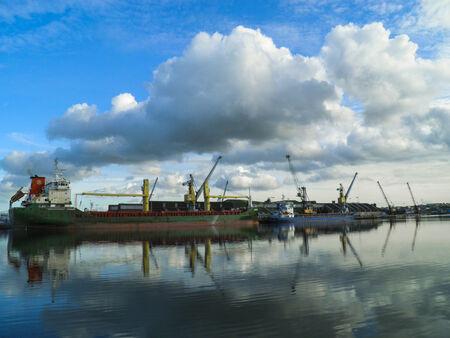 flew: a big boat in port flew through clouds
