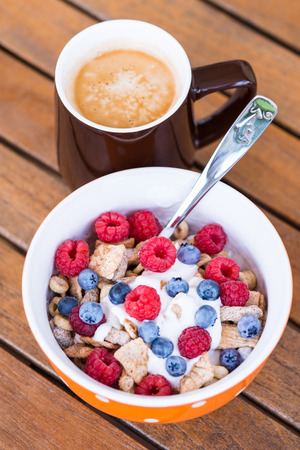 Healthy breakfast  - Cornflakes with fresh fruits, yogurt and coffee photo