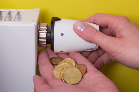 conform: Radiator adjustment to save energy. Save energy and money concept Stock Photo