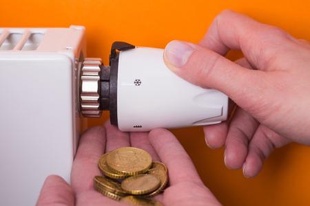 Radiator adjustment to save energy. Save energy and money concept 写真素材