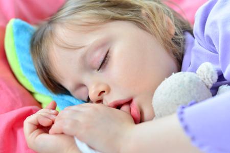 Sleeping little cute baby sucking thumb Stok Fotoğraf