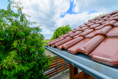 arbor: Tiled roof of wooden arbor with galvanized gutter