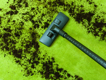 Photo Of Vacuum Cleaner Cleaning Dirt On Carpet. Spring Cleaning Concept