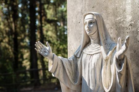statue: Santa Caterina Statue in the MONTE OLIVETO MAGGIORE ABBEY; Santa Caterina - Doctor of the Church, Patron Saint of Italy and Europe