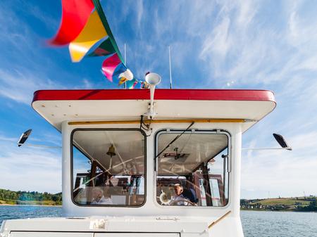 wheelhouse: Niedzica, Poland - August 28, 2015: wheelhouse of tourist boat on Czorsztynskie lake. Popular way - for many tourists - to get to ruins of Czorsztyn castle Editorial