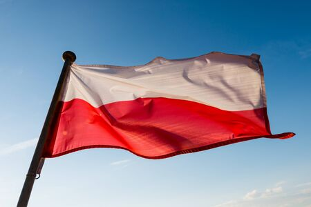 mast: Polish flag on the mast against blue sky Stock Photo