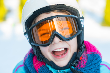 snowboard: Ski, skier girl, winter vacation, snow, skier, sun and fun - portrait of girl in goggles enjoying ski