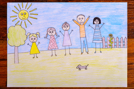 crayon drawing: Happy family drawing - kids crayon drawing on wooden table Stock Photo