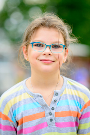 disheveled: Girl in eyeglasses with disheveled hair and - portrait full of positive emotions