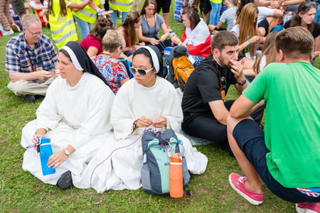 Poznan, POLAND - JULY 24, 2016: pilgrims praying, dancing and singing during Days In Dioceses just before The World Youth Day in Krakow; WYD is a meeting of youth from all over the world