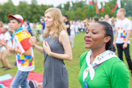 mob: Poznan, POLAND - JULY 24, 2016: pilgrims praying, dancing and singing during Days In Dioceses just before The World Youth Day in Krakow; WYD is a meeting of youth from all over the world