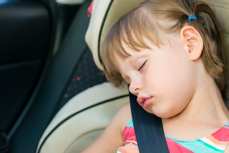 Toddler Girl Asleep In A Child Safety Seat Car Stock Photo