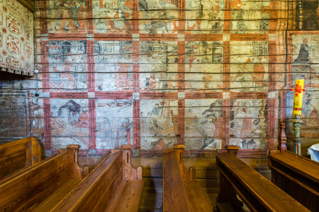 Grywald, POLAND - August 11, 2016; Interior of  wooden 15th century St Martin of Tours Church; with its magnificent mural polychrome from 1618, a 16th century Gothic triptych representing St Martin