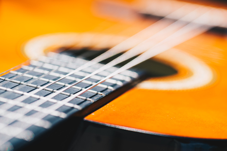 Detail of classic guitar with very shallow depth of field