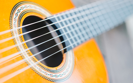 Acoustic guitar bridge and strings close up - macro - very shallow depth of field Stock Photo