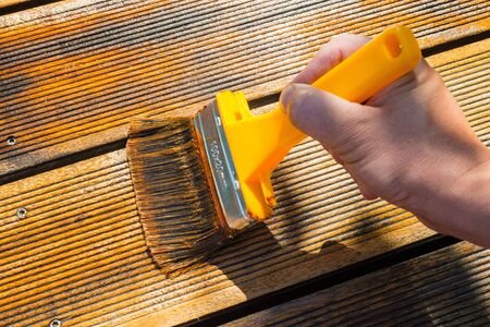patio deck: Oiling Terrace with Wide Brush - painting wooden patio deck with protective oil