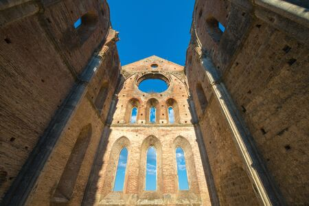 Internal view of the ruins of Medieval San Galgano Abbey near Siena, Italy - example of romanesque architecture in Tuscany Stock Photo