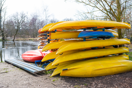 Rental kayaks and canoes on the riverbank at Welna River Wielkopolska Stock Photo