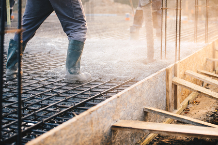 Concrete pouring during commercial concreting floors of buildings in construction - concrete slab Stock Photo