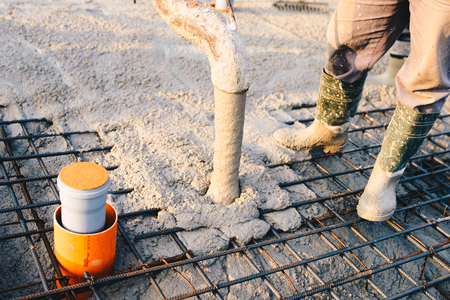 Concrete pouring during commercial concreting floors of buildings in construction - concrete slab 스톡 콘텐츠