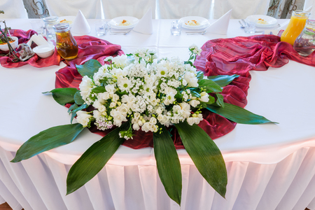 bouquet of flowers on a wedding table - wedding floral table decoration